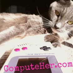 My kitty listening to my new songs on my Game Boy